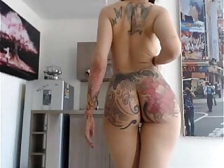 tattooed girl with piercing gets her ass spanked